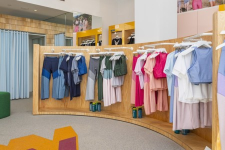 outdoor voices athletic gear on clothing racks in store