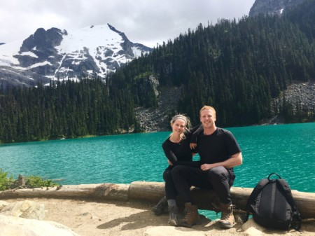 nurse monica gingell with partner in front of lake and trees