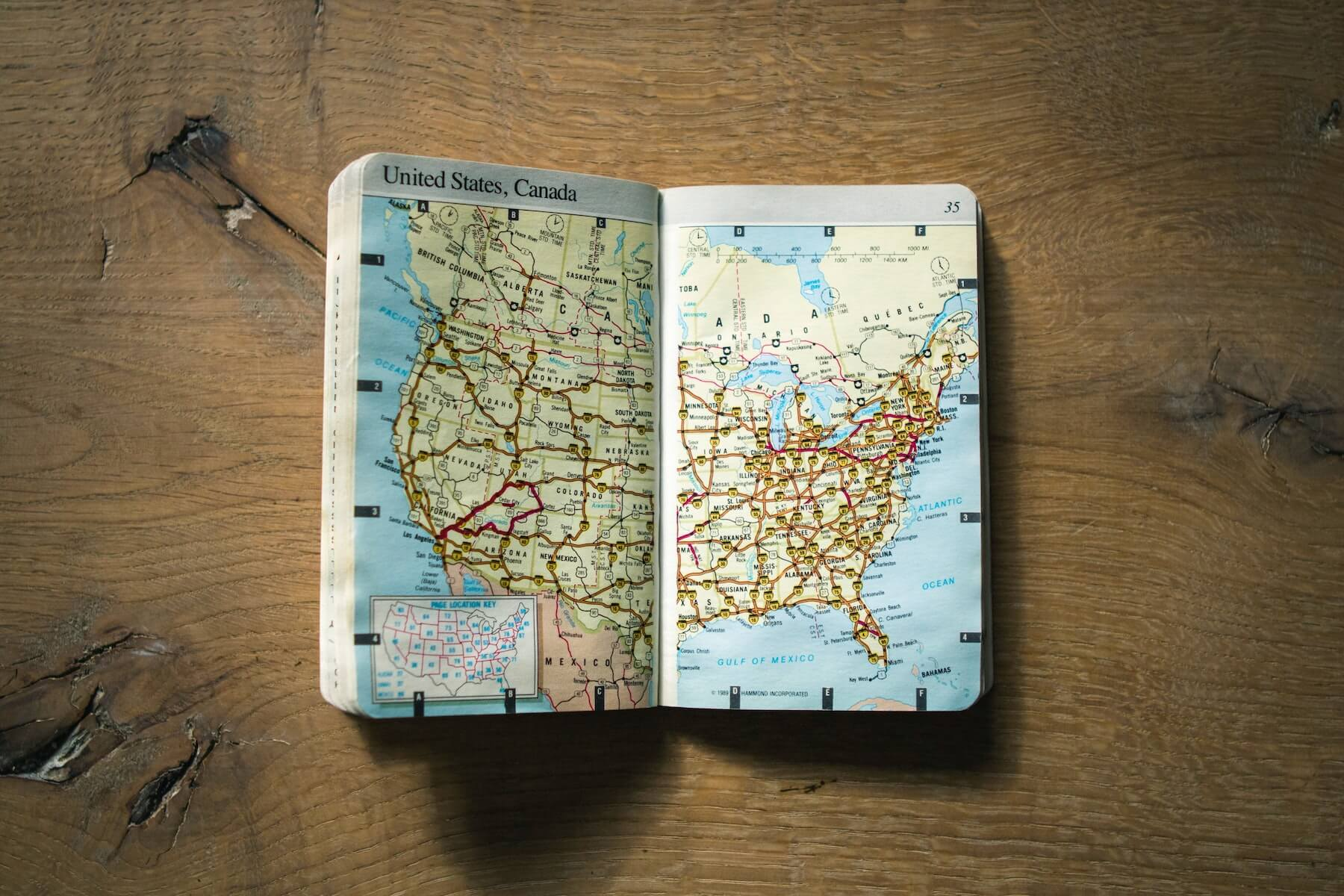 map book folded open on wood table map of united states nurse licensure compact states