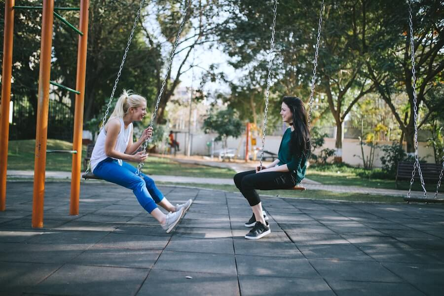 two women on swings facing each other talking things nurses should know
