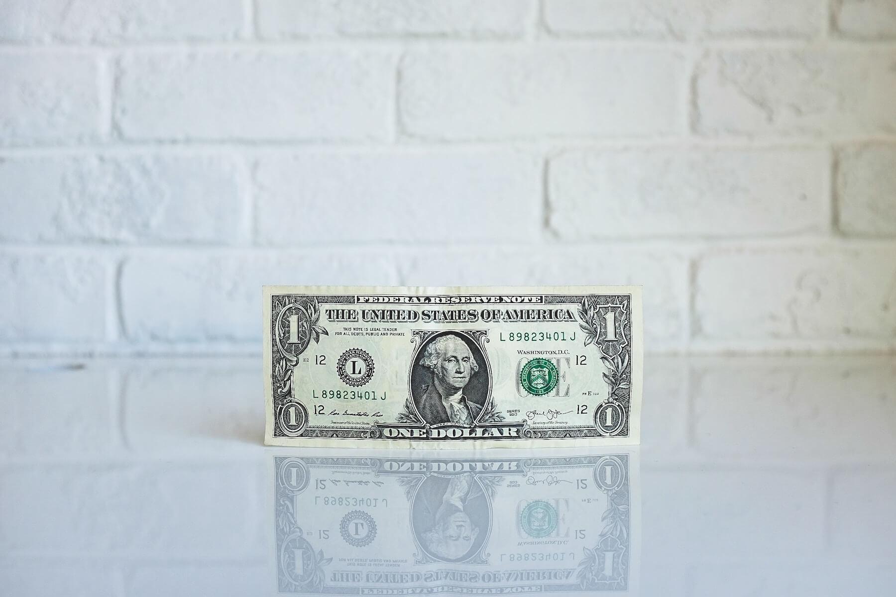 dollar against white background nursing school debt