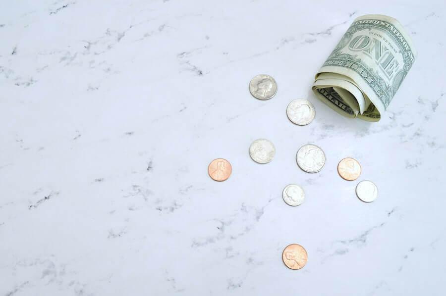 american money on marble table nursing finances
