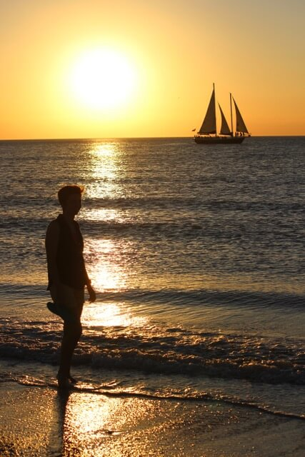 travel nurse enjoying sunset on travel assignment holmes