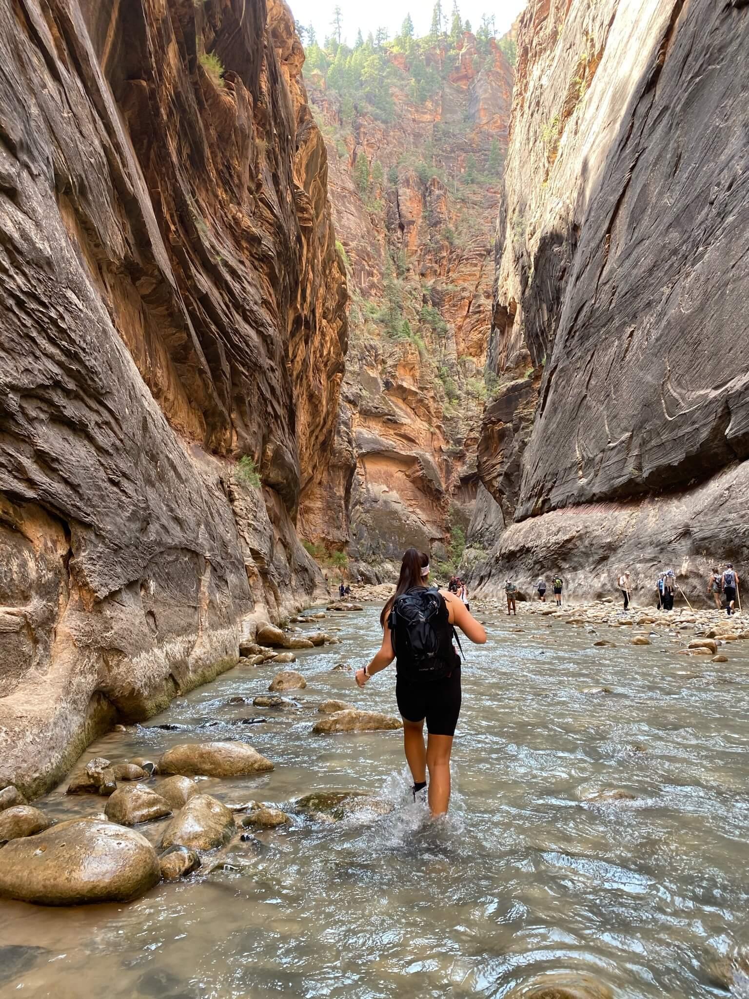 Andrea in between two rock walls.