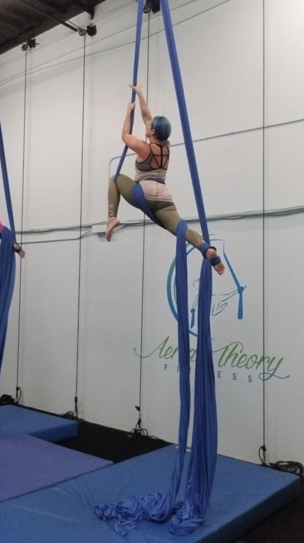 nurse ashley bowlin hanging from acro yoga ribbons
