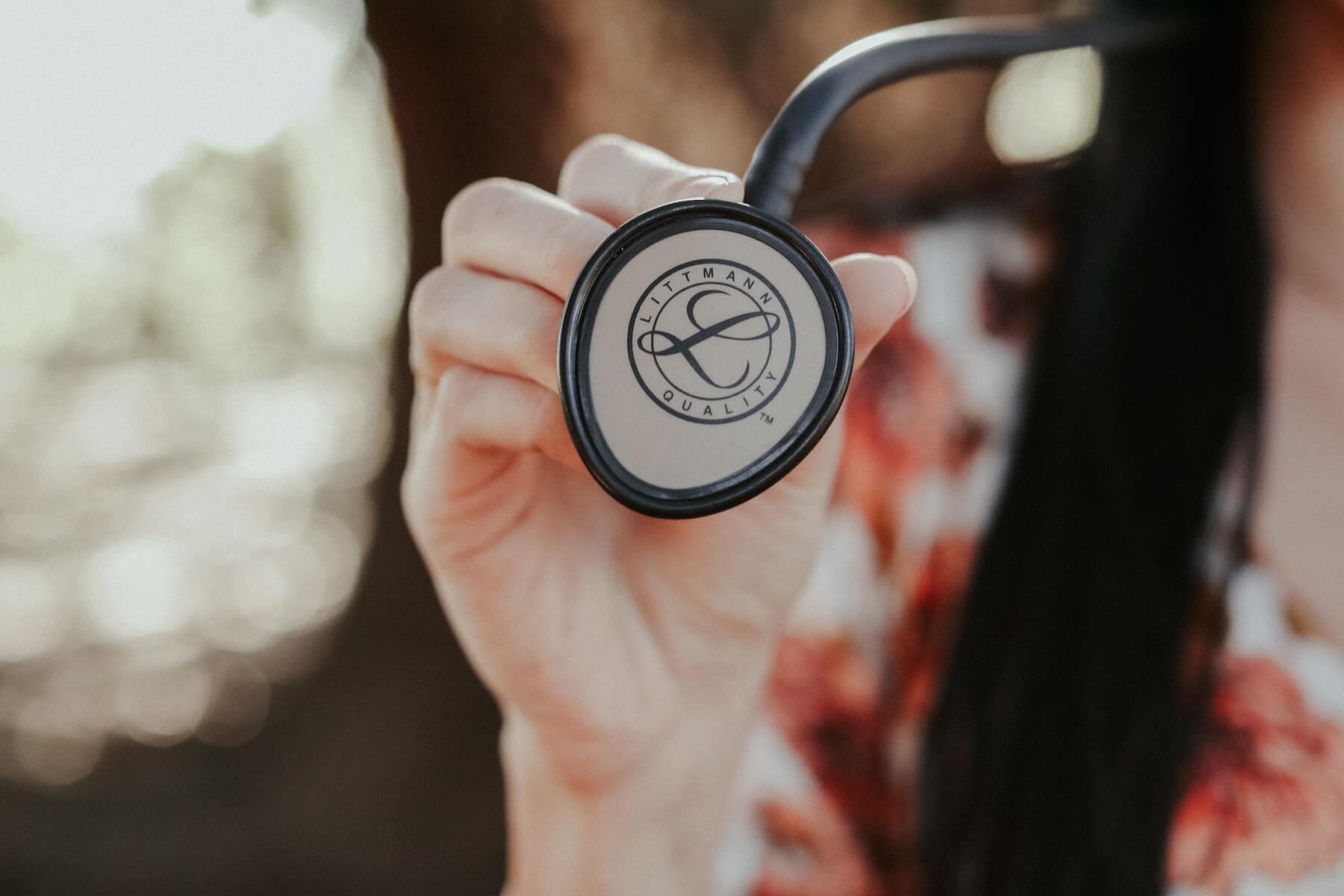 woman holding stethoscope littmann future of nursing education