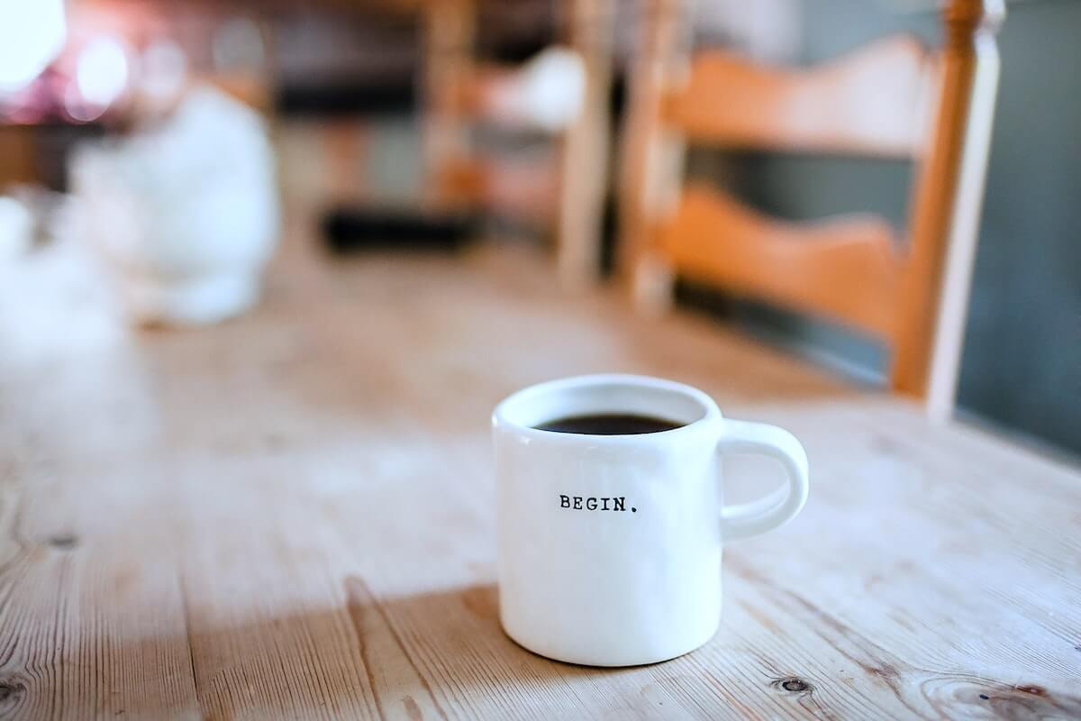 coffee mug with begin written on it sitting on dining room table begin investing for nurses