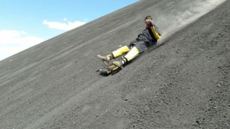 budget travel sliding down hill in nicaragua