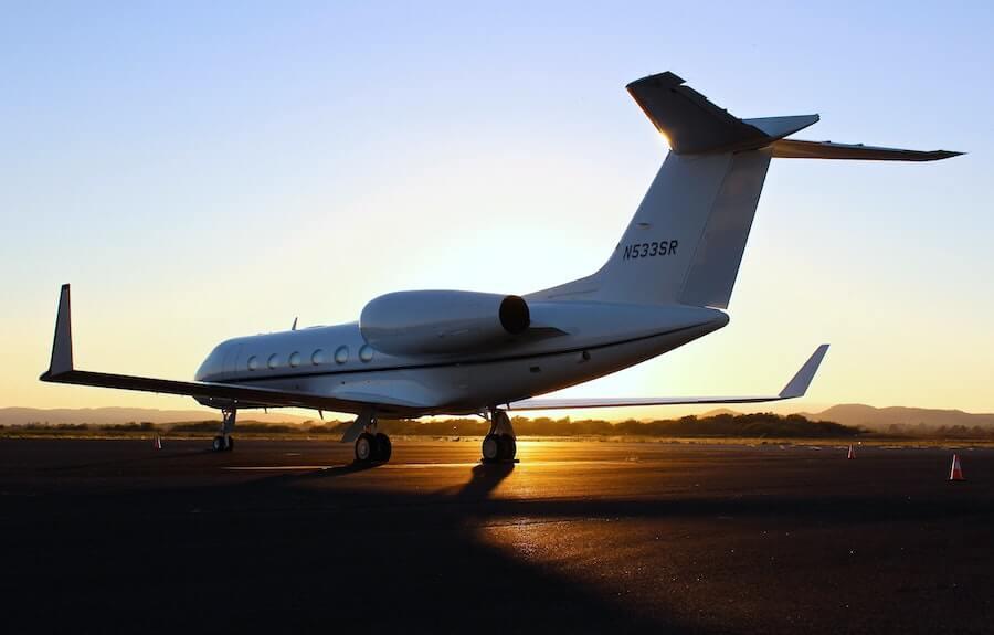 plane on runway at sunset travel nursing flight staff nurse to travel nurse