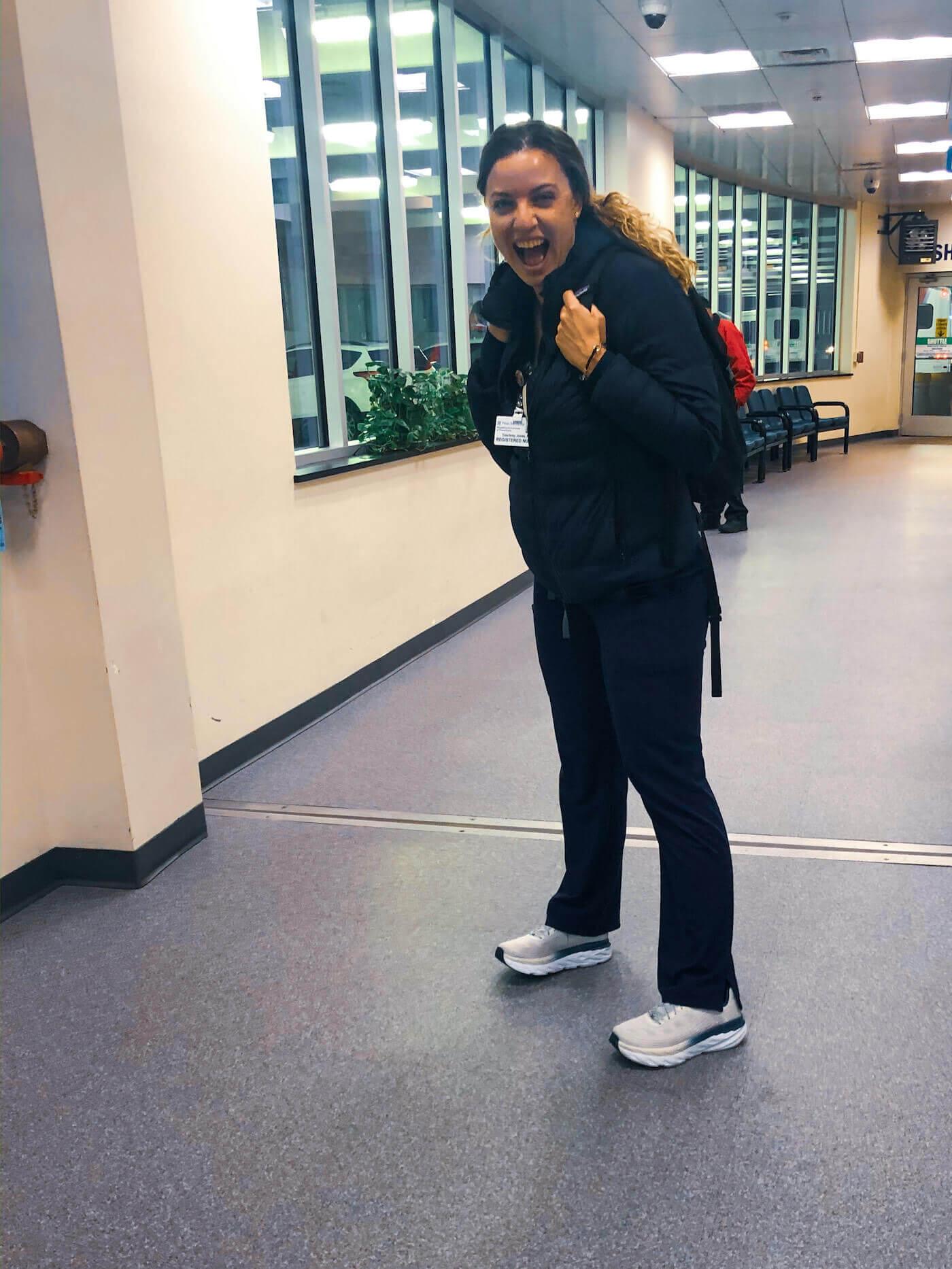 nurse courtney jones wearing hoka shoes in hospital garage hoka nursing shoes