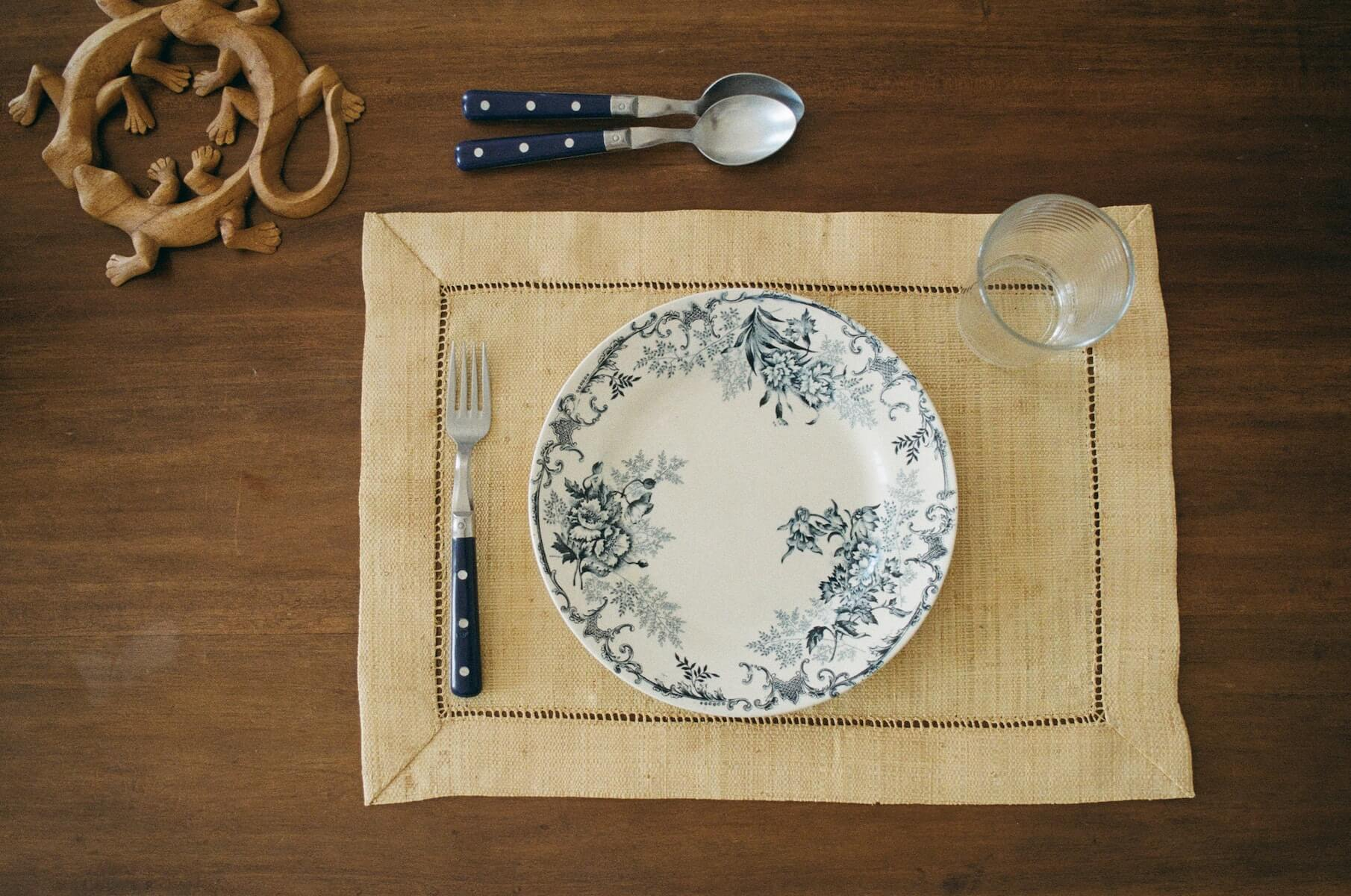 empty plate on table with utensils and empty glass intermittent fasting for nurses