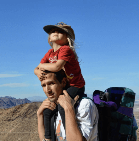 russ mortland nurse with child on back in desert