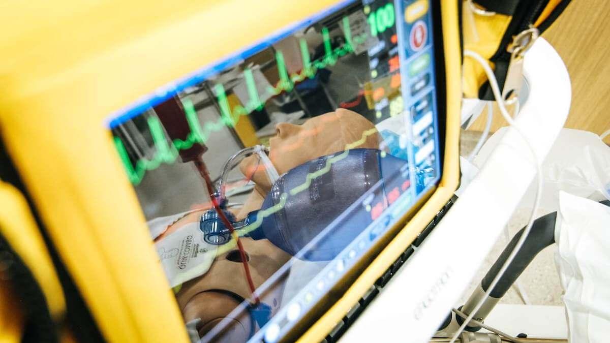 reflection of healthcare model in pulse machine display cardiac care nurse