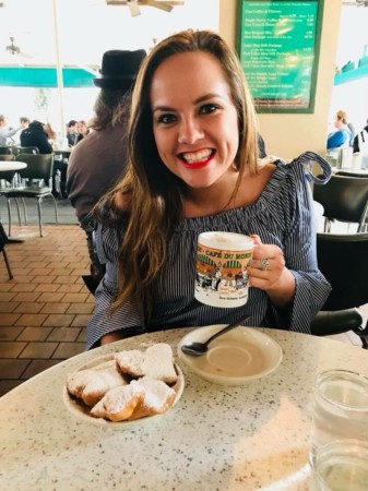 nurse leah gnitka sitting in cafe with coffee